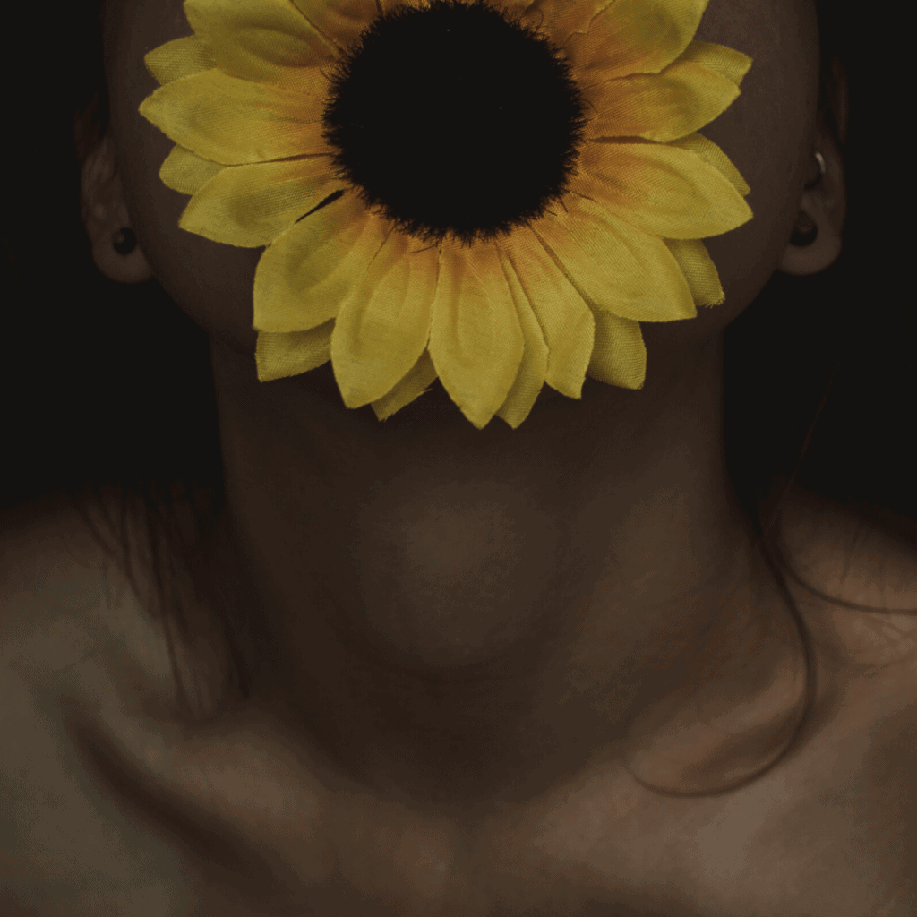 woman with sunflower on mouth