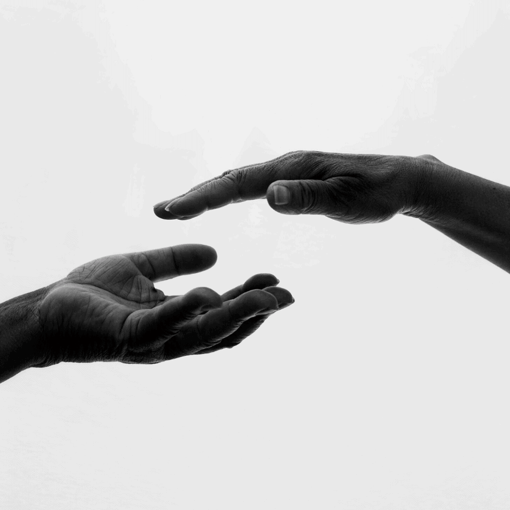 two hands trying to reach each other