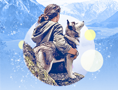 an image of a white woman woman wearing a hoodie while holding a dog with mountains in the background