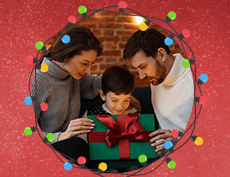 an image of a white family with mom, dad and their boy child opening his Christmas present with Christmas lights surrounding them in circle